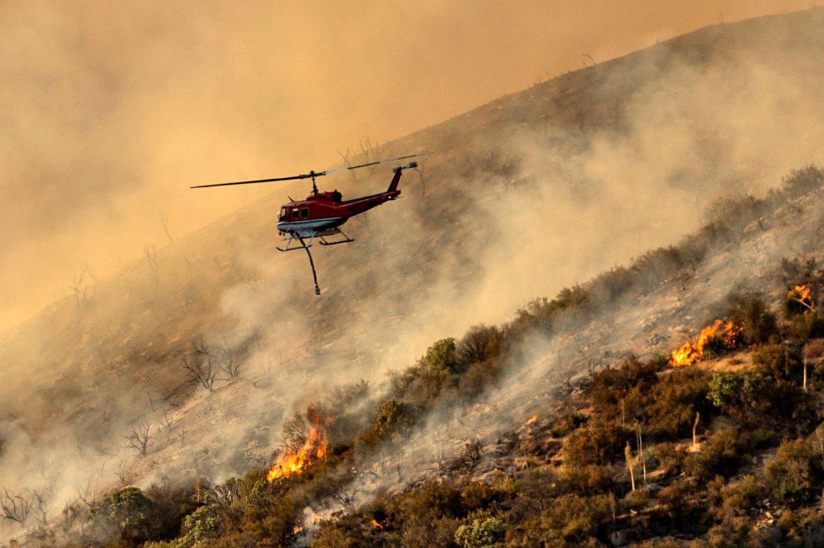 Crews scramble as massive California wildfire burns homes, new ...