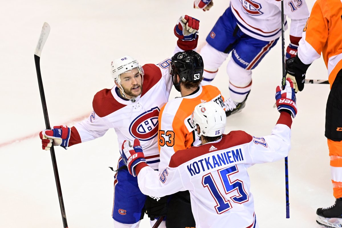 Montreal Canadiens centre Jesperi Kotkaniemi (15) celebrates his goal against the Philadelphia Flyers with teammate Jonathan Drouin (92) as Flyers defenceman Shayne Gostisbehere (53) skates away during the first period of NHL Eastern Conference Stanley Cup first-round playoff action in Toronto on Friday, Aug. 14, 2020.