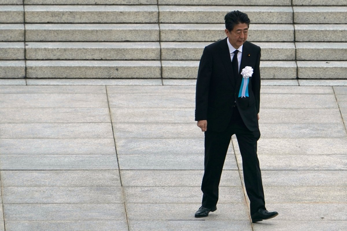 In this Aug. 6, 2020, file photo, Japanese Prime Minister Shinzo Abe walks off after delivering a speech during a ceremony to mark the 75th anniversary of the bombing at the Hiroshima Peace Memorial Park, in Hiroshima, western Japan.