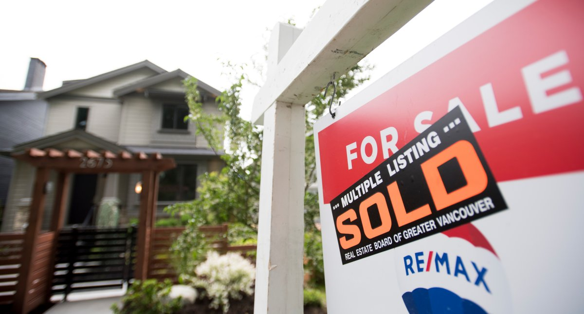 FILE - A real estate sign is pictured in Vancouver, B.C., Tuesday, June, 12, 2018. The Canadian Real Estate Association says home sales in July hit a record high as they continued their rebound from the lows of earlier this year when the COVID-19 froze the market. THE CANADIAN PRESS Jonathan Hayward.