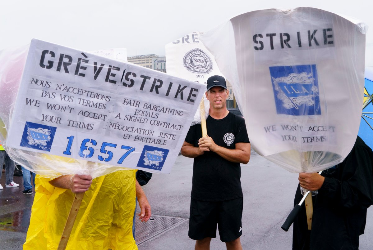 Striking Port of Montreal workers walk the picket line in Montreal on Monday, Aug. 17, 2020.