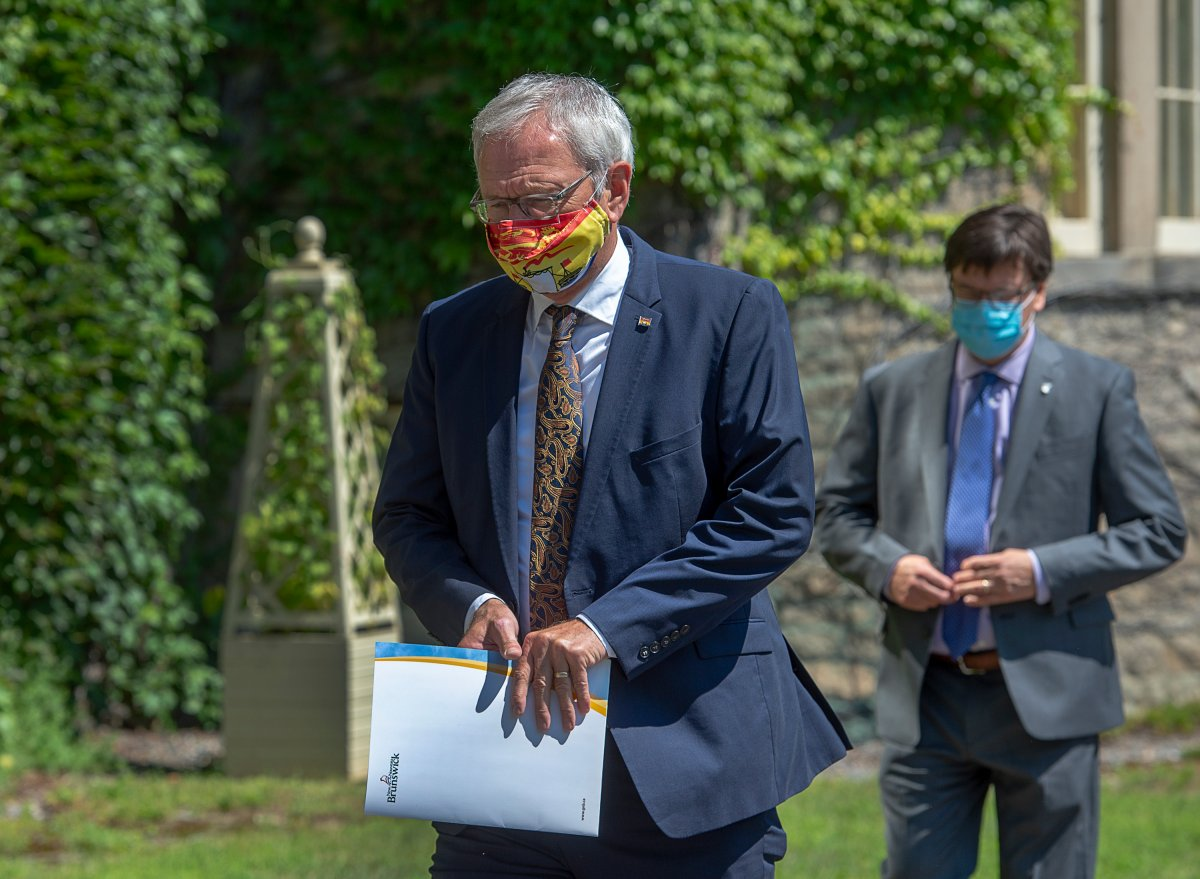 New Brunswick Premier Blaine Higgs, followed by an aide,  pays a visit to Lt.-Gov Brenda Murphy at Government House in Fredericton on Monday, Aug. 17, 2020 to ask her to disolve the legislature. A provincial election will be held September 14. THE CANADIAN PRESS/Andrew Vaughan.