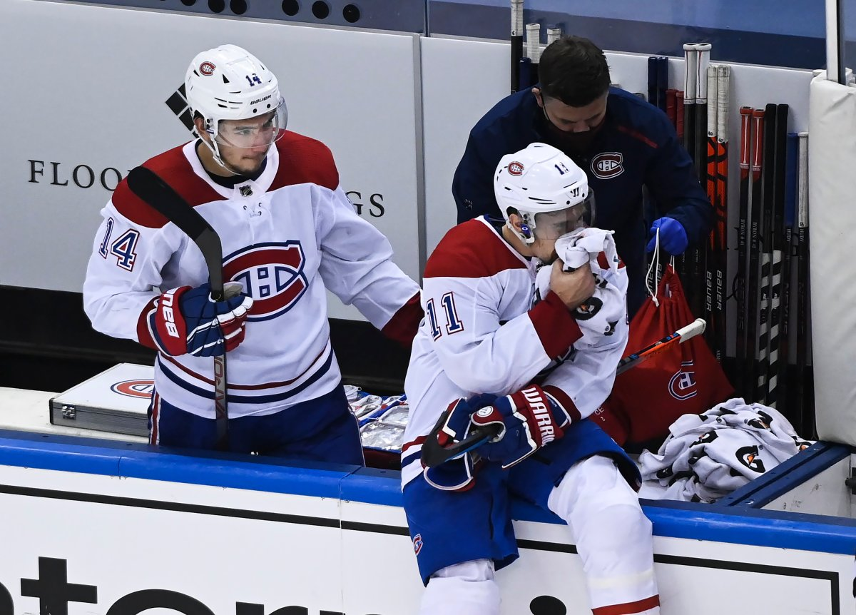Montreal Canadiens right wing Brendan Gallagher (11) holds a towel on his mouth as Canadiens centre Nick Suzuki (14) checks on him after defeating the Philadelphia Flyers during NHL Eastern Conference Stanley Cup playoff hockey action in Toronto on Wednesday, August 19, 2020.