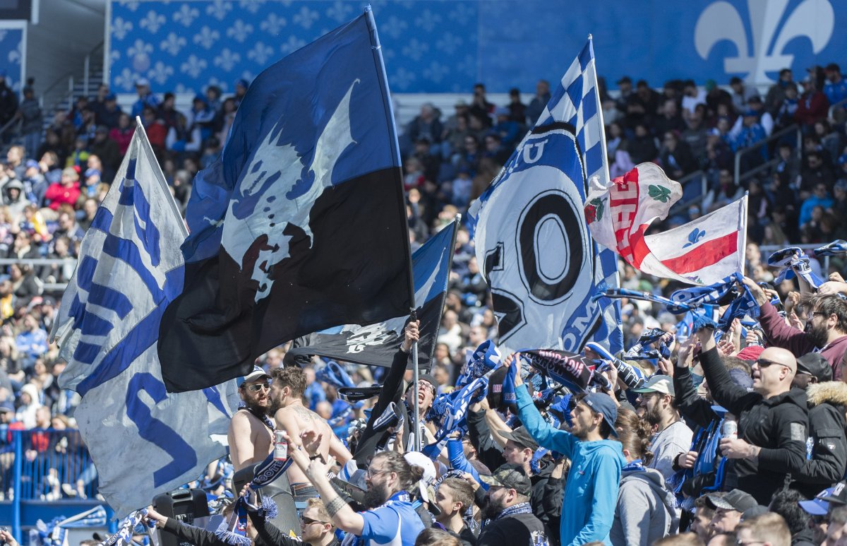 Montreal Impact fans cheer on their team during second half MLS soccer action against Columbus Crew SC in Montreal, Saturday, April 13, 2019. The Montreal Impact say they will have some fans at their first Major League Soccer home game during the COVID-19 pandemic next week. The club says a maximum of 250 people will be allowed in 20,081-seat Stade Saputo when the Impact face the Vancouver Whitecaps next Tuesday.