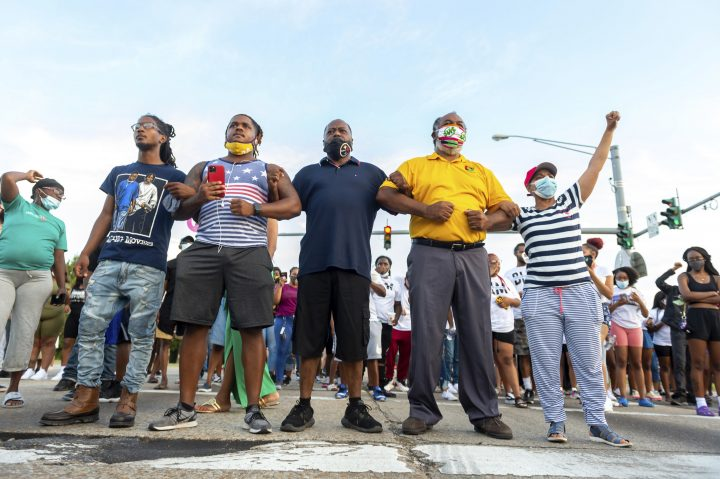 Protesters take to the street and block traffic at the intersection of Willow Street and Evangeline Thruway after a vigil held Saturday, Aug. 22, 2020, in Lafayette, La., for 31-year-old Trayford Pellerin, who was shot and killed by Lafayette police officers while armed with a knife the night before.