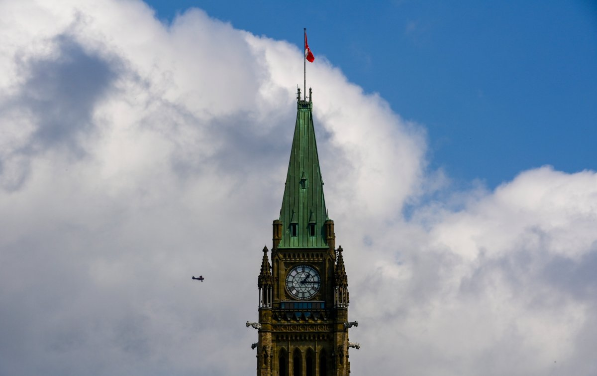 A small tourist plane passes over downtown Ottawa at Parliament Hill on Monday, Aug. 24, 2020.