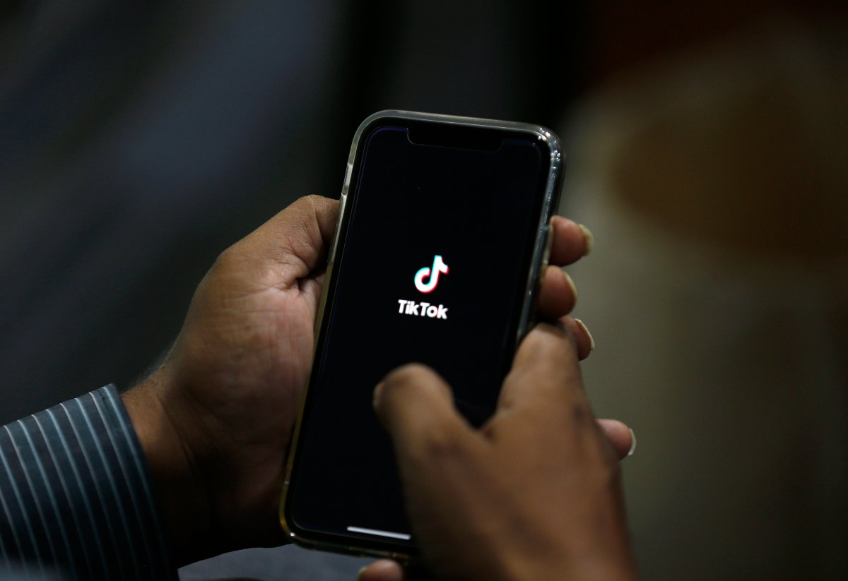 FILE - In this July 21, 2020 file photo, a man opens social media app 'TikTok' on his cell phone, in Islamabad, Pakistan.