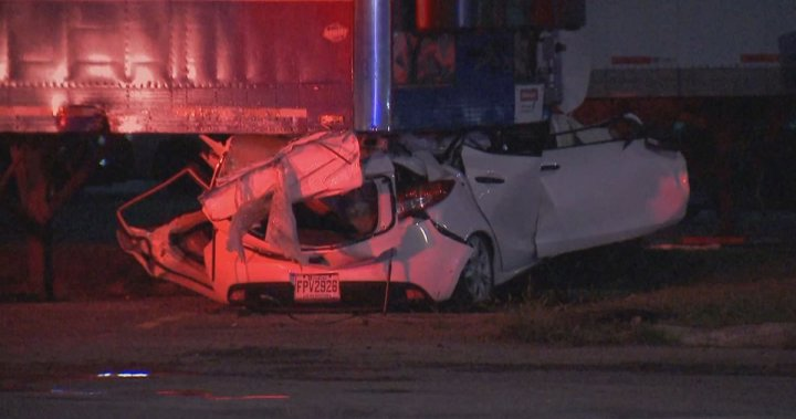 Police investigating after car crashes into parked trailer in Montreal's west end