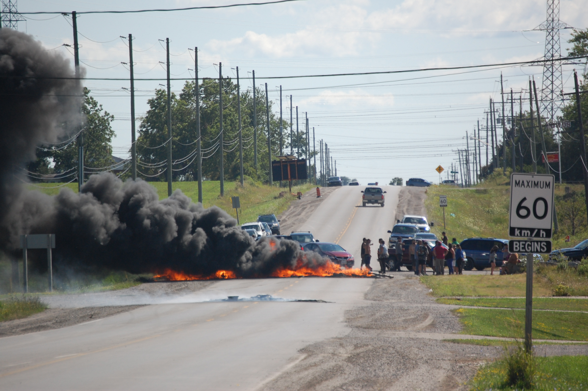 OPP closed off roads for several hours as a group of protesters lit tires on Highway 6 near Argyle Street in Caledonia, Ont on Aug. 5, 2020.