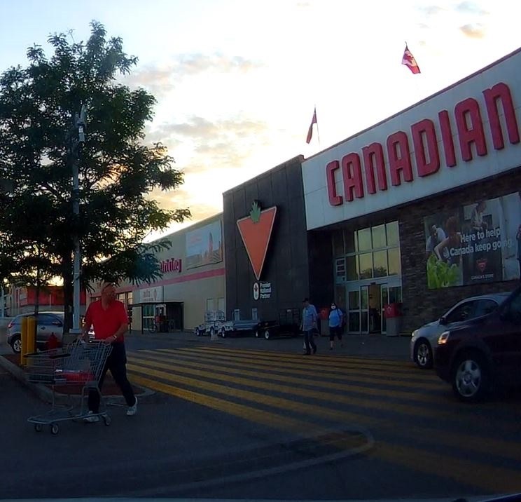 Ottawa police say they're still looking to speak with the three people pictured here in relation to a hit-and-run near an Ottawa Canadian Tire on Friday, July 31, 2020.