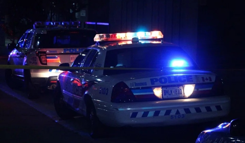 Toronto police cruisers are seen at parked on a street.