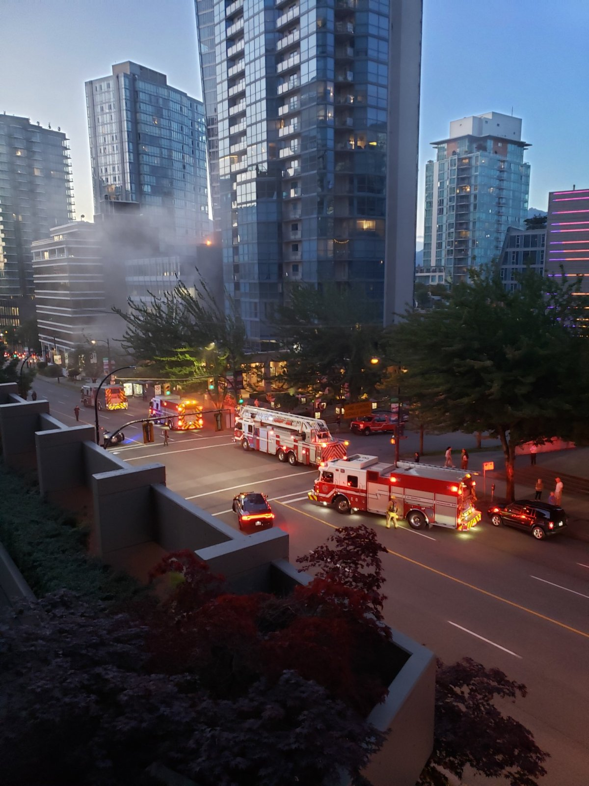 Vancouver fire crews had to make their way carefully through thick smoke to determine the source somewhere in the lower level of a seven storey commercial building in Coal Harbour Sunday evening.