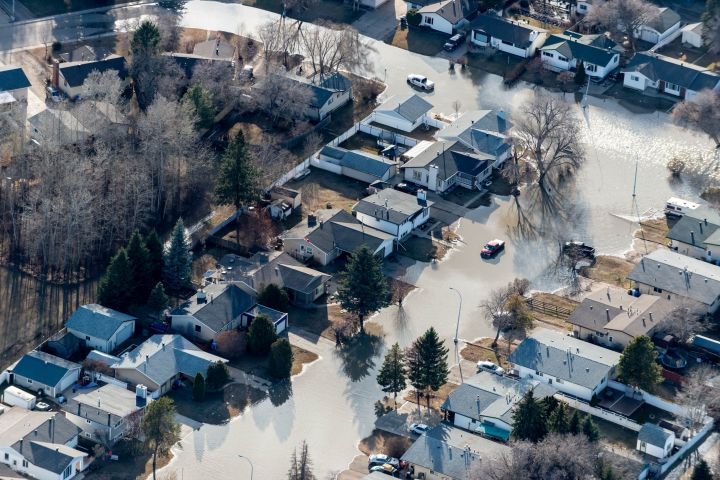 An erial view of the flooding in downtown Fort McMurray is shown on Tuesday, April 28, 2020. An April flood that led to the evacuation of several northern Alberta communities during this spring's ice breakup has caused more than half a billion dollars in insured damage.