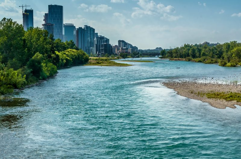 The quickly flowing Bow River runs through downtown Calgary in summer.