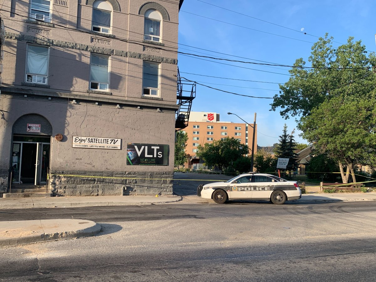 Winnipeg police outside the Mount Royal Hotel on Aug. 6.