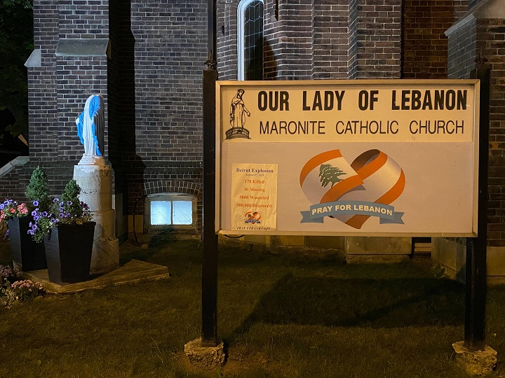 The vandalized statue of the Virgin Mary can be seen outside the church in Toronto.