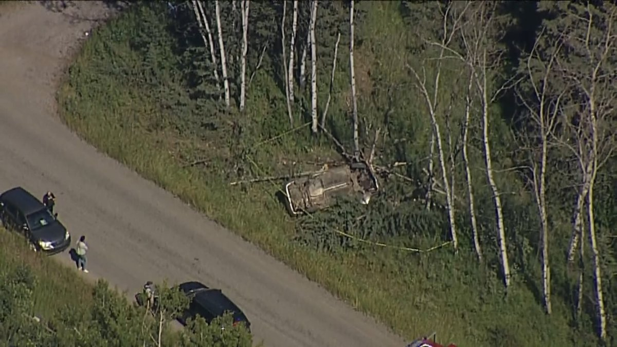 First responders at the scene of a crash near Priddis, Alta., on Aug. 25, 2020.