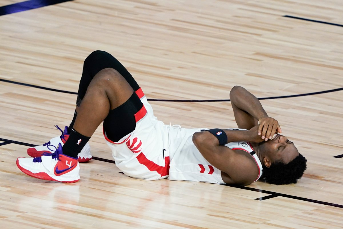 Toronto Raptors' OG Anunoby lies on the court after a collision during the second half of an NBA basketball conference semifinal playoff game against the Boston Celtics Sunday, Aug. 30, 2020, in Lake Buena Vista, Fla.