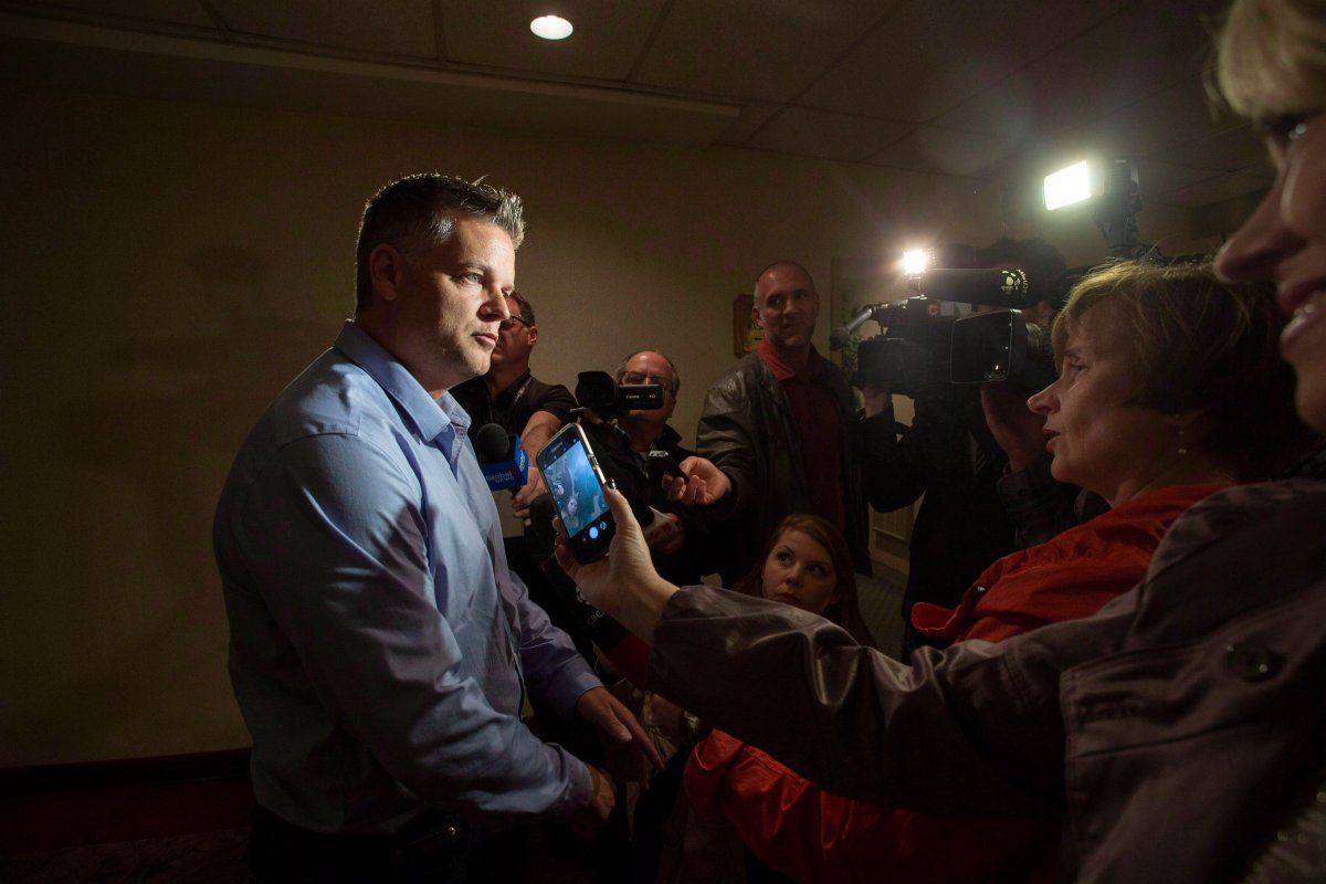 New Brunswick Progressive Conservative candidate Robert Gauvin answers questions from the media in Fredericton on Thursday, Sept. 27, 2018. A former Tory deputy premier is now the Liberal candidate for the riding of Shediac Bay-Dieppe in New Brunswick's provincial election. Liberal Leader Kevin Vickers announced the nomination of Robert Gauvin this morning.