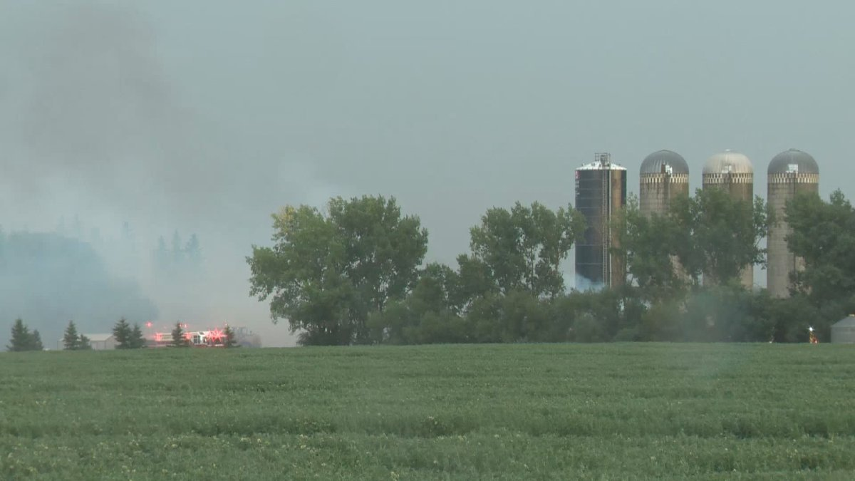 Heavy equipment and 32 firefighters were deployed to a blaze at a barn in Sturgeon County late Monday afternoon.