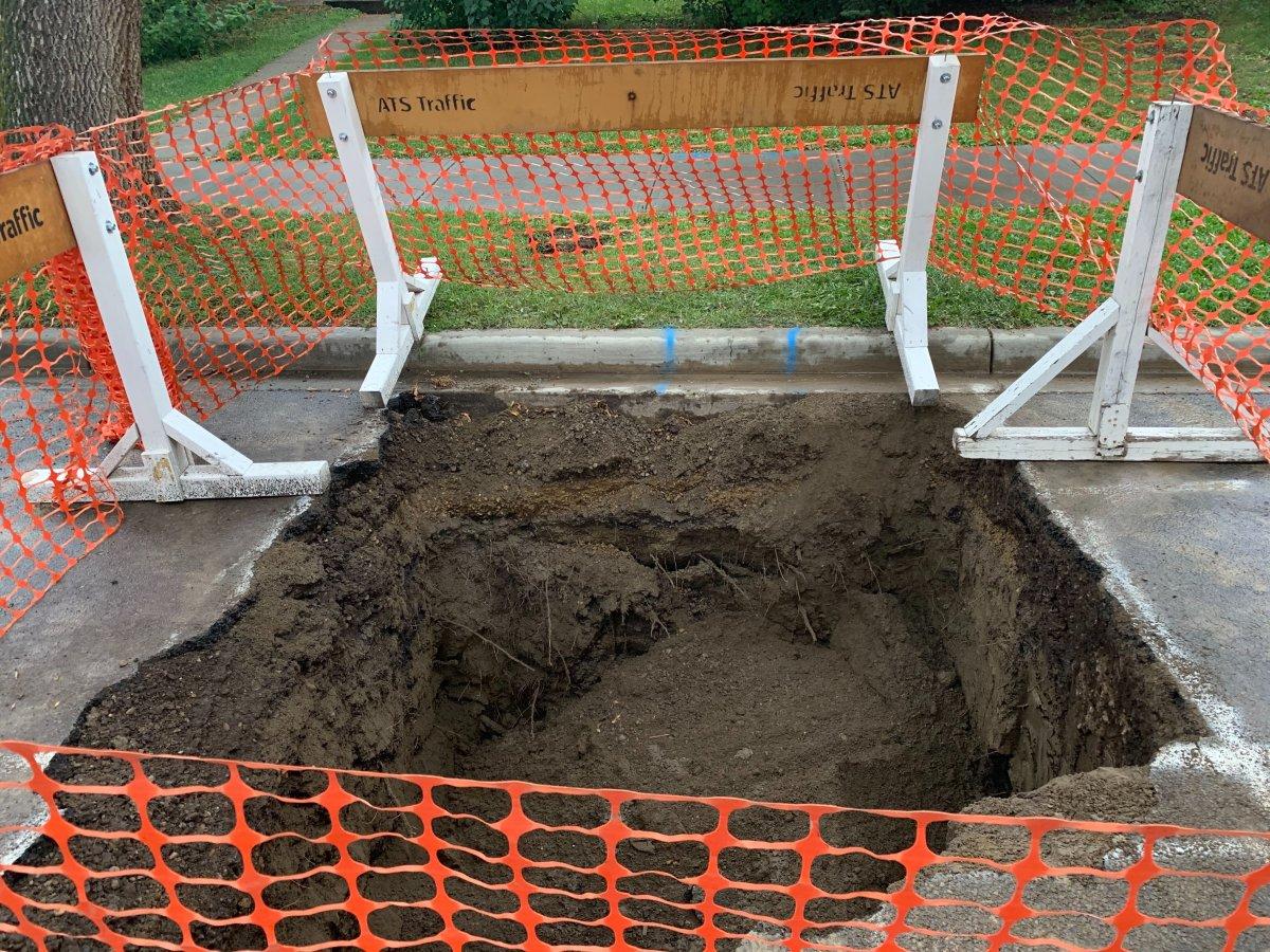 Epcor crews repair sink hole in Edmonton's Bonnie Doon neighbourhood, Saturday, Aug. 22, 2020.