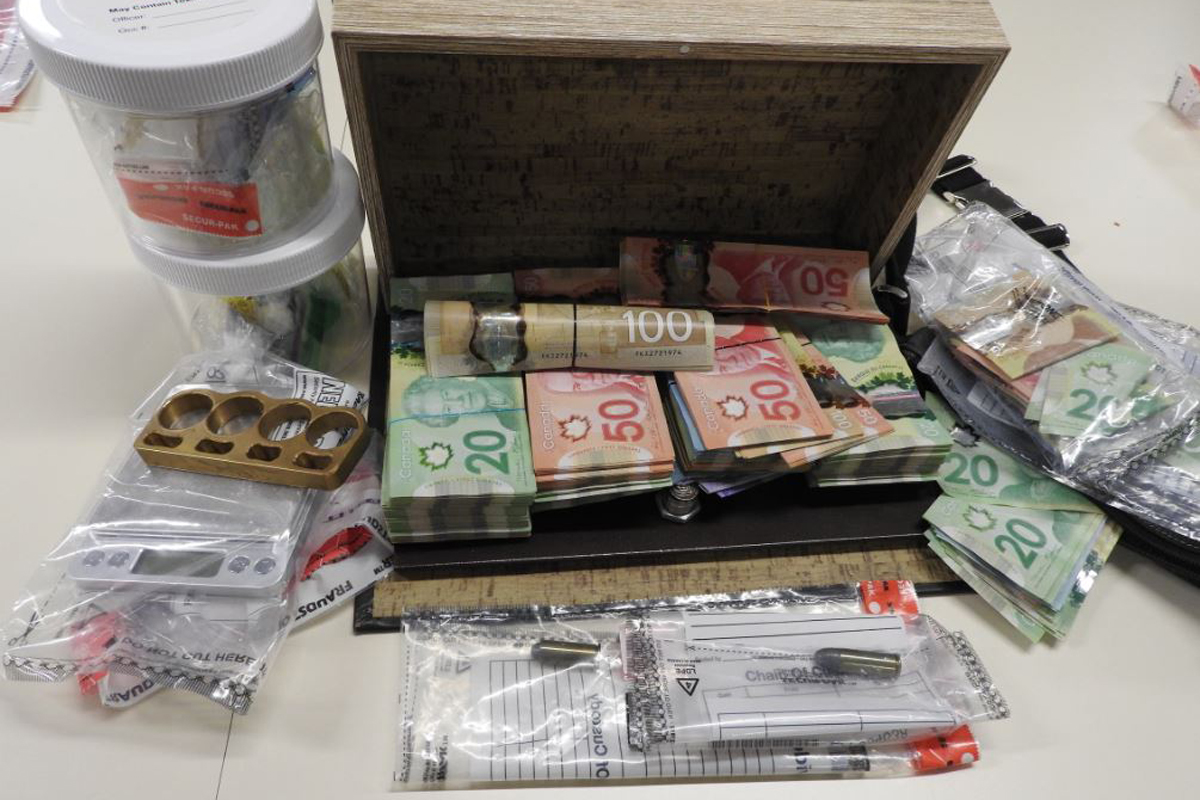 Waterloo Regional Police say drugs, cash and weapons were seized as part of the investigation.