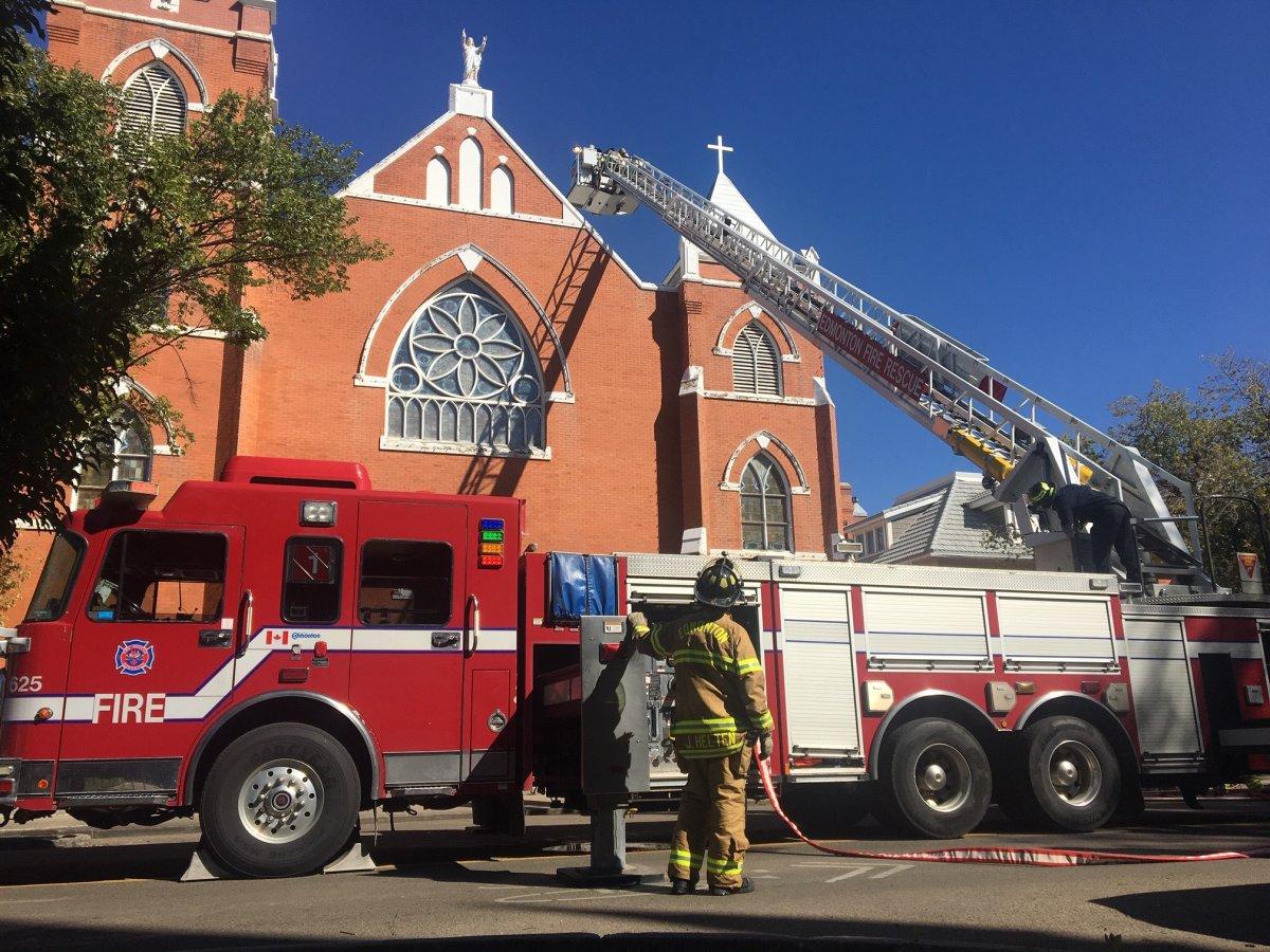 Fire crews on scene at the Sacred Heart Catholic Church on Sunday, Aug. 30, 2020.