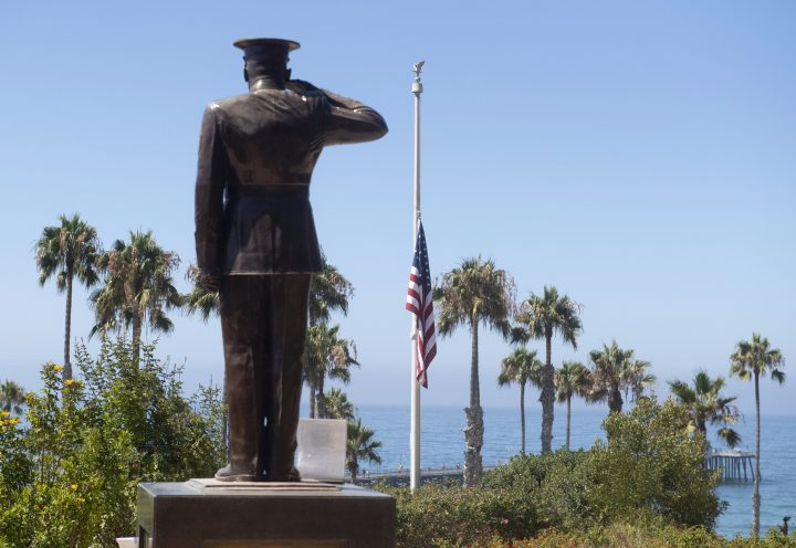 The U.S. flag was lowered to half-staff at Park Semper Fi in San Clemente, Calif., on Friday, July 31, 2020. Officials say a military seafaring assault vehicle with 15 Marines and a Navy sailor aboard sank off the coast of Southern California, leaving one of the Marines dead and eight missing. A Marine Corps spokesman says they were traveling in the amphibious assault vehicle from the shores of San Clemente Island to a Navy ship Thursday evening when they reported that the vehicle was taking on water.