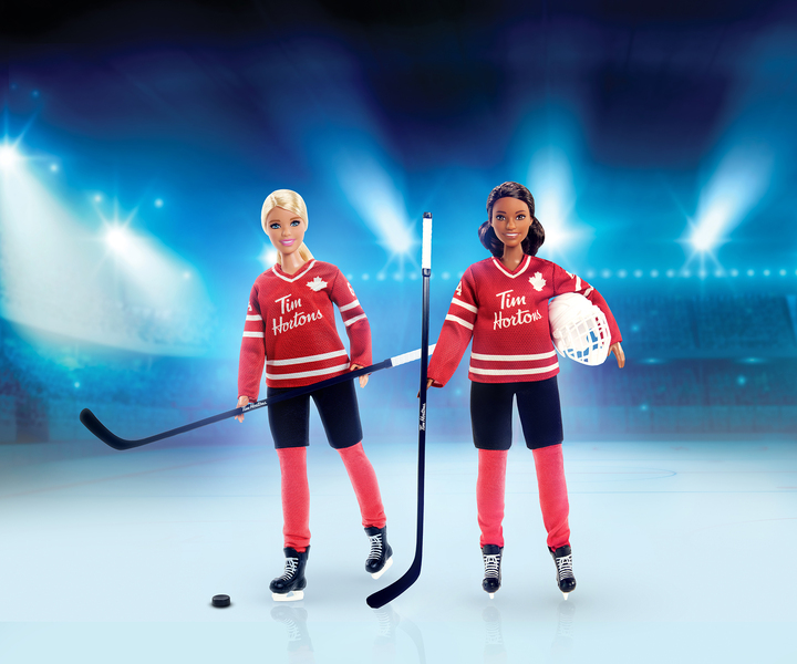 A spokeswoman for Tim Hortons says its restaurants won't be selling a new Barbie made in collaboration with the coffee chain until both Black and white versions of the hockey-themed dolls, seen in an undated handout photo, are available.