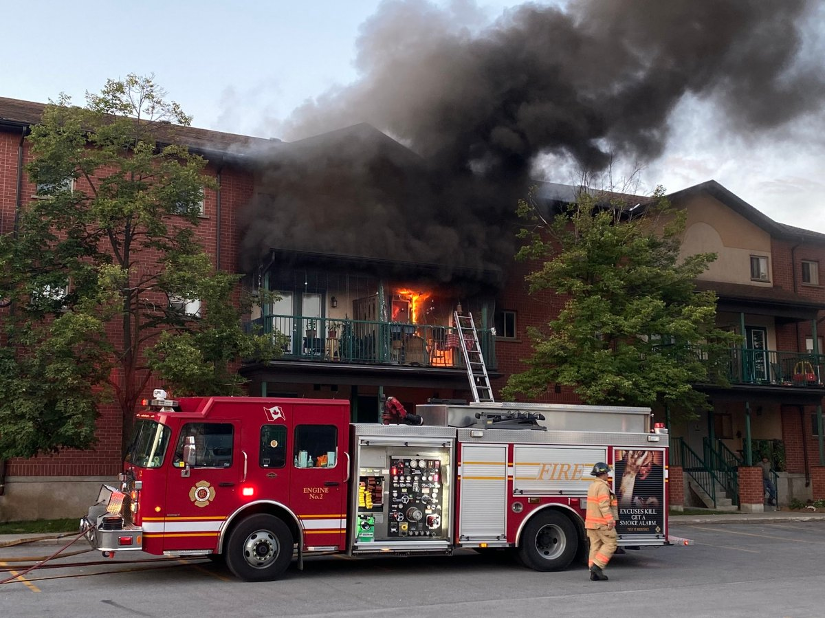 London fire crews can be seen dousing a blaze and heavy smoke that is pouring out of 654 King St.