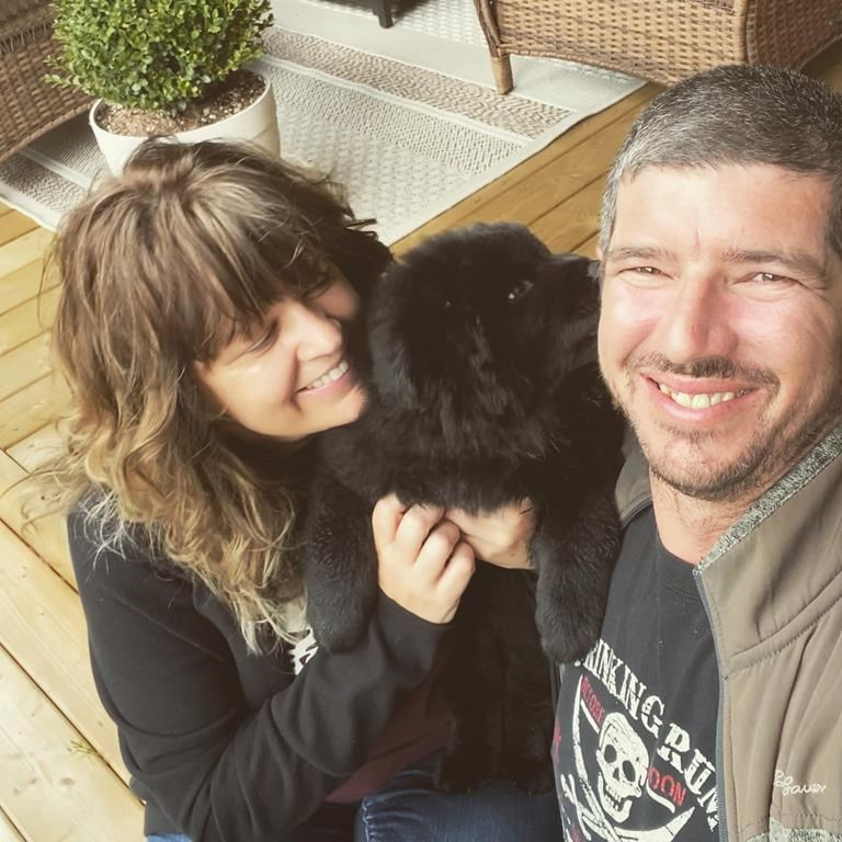 Stewart, B.C. Mayor Gina McKay poses for a photo with her partner Chris Fellers and their puppy Harper in this undated handout photo. The town of Stewart, B.C., is doing what it can to help neighbours in the smaller, more isolated Hyder, Alaska. Stewart Mayor Gina McKay said residents of Hyder don't even have a gas station, and are allowed to cross into Stewart once a week for essentials like groceries.