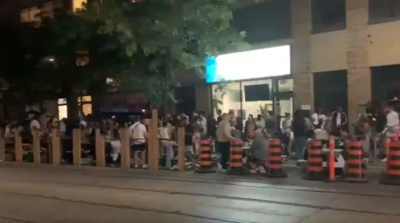 A photo of crowding at a bar in Toronto.