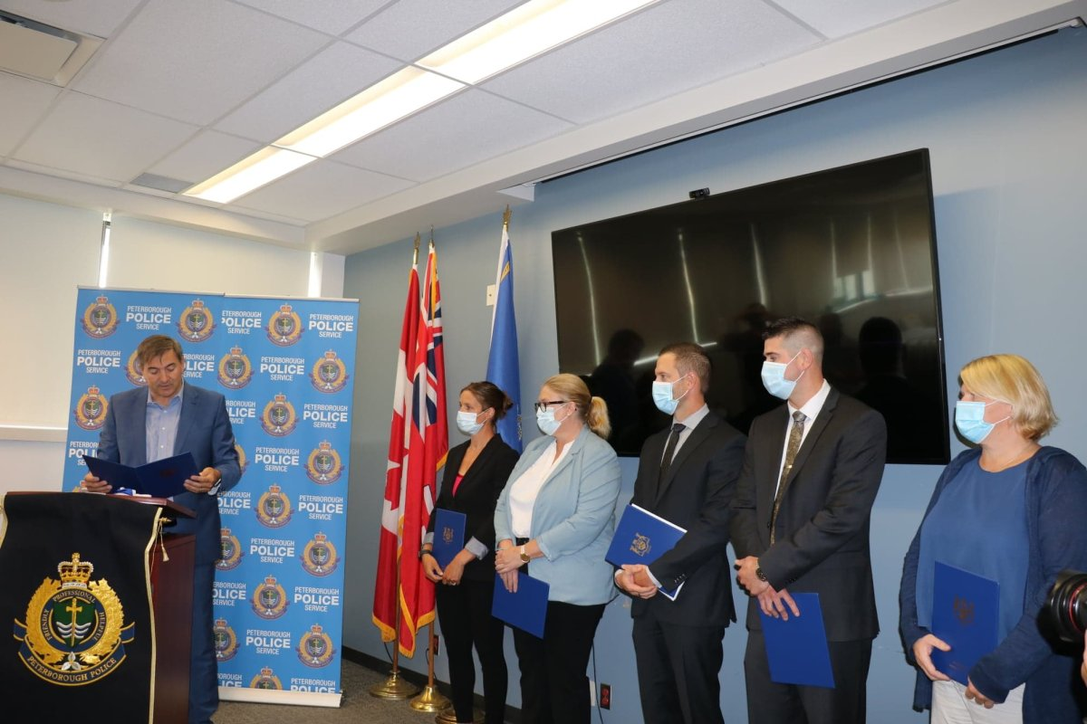 Peterborough-Kawartha MPP Dave Smith congratulates members of the Peterborough Police Service special victims unit during a funding announcement Tuesday at the police station.
