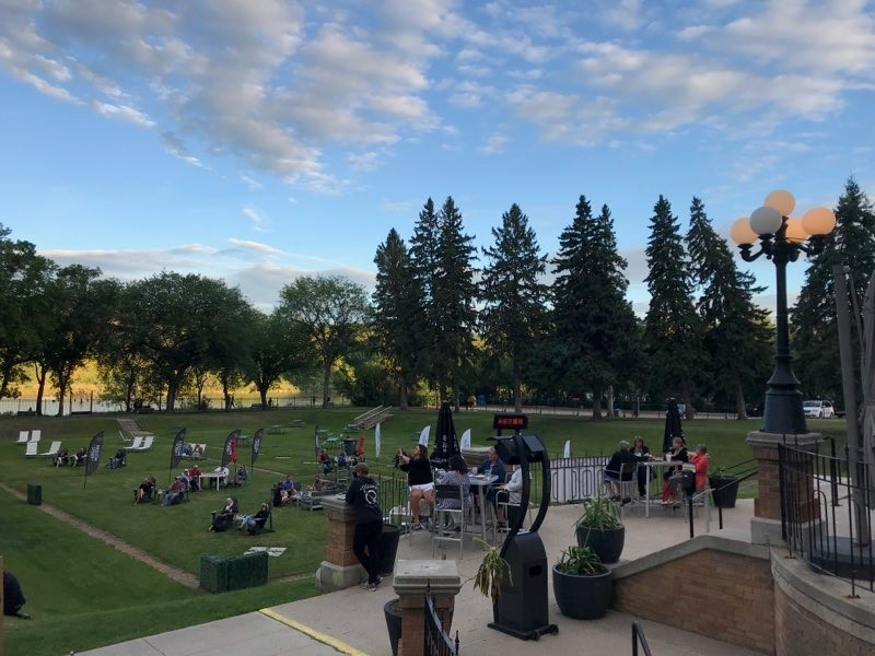 """Music fans gather near the South Saskatchewan River as Heidi Munro and Scott Patrick perform at the free """"Summer Nights Series"""" on Aug. 15, 2020."""
