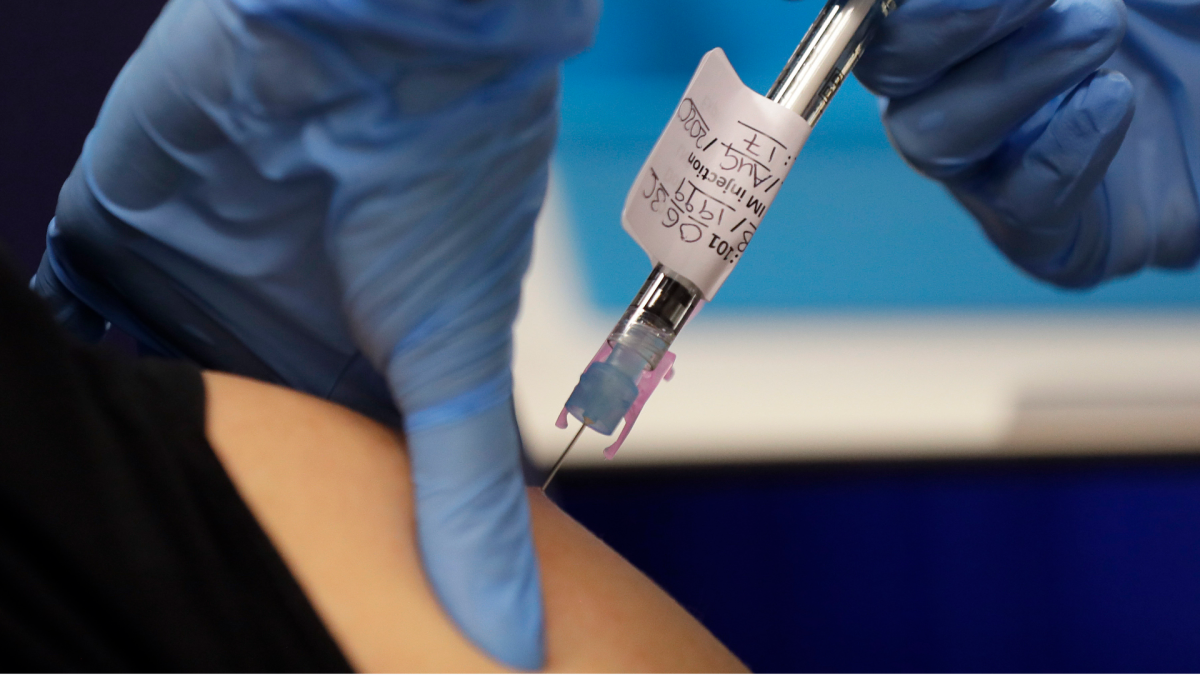 A volunteer is injected with a trial vaccine as part of a vaccine trial at a clinic in London, England.