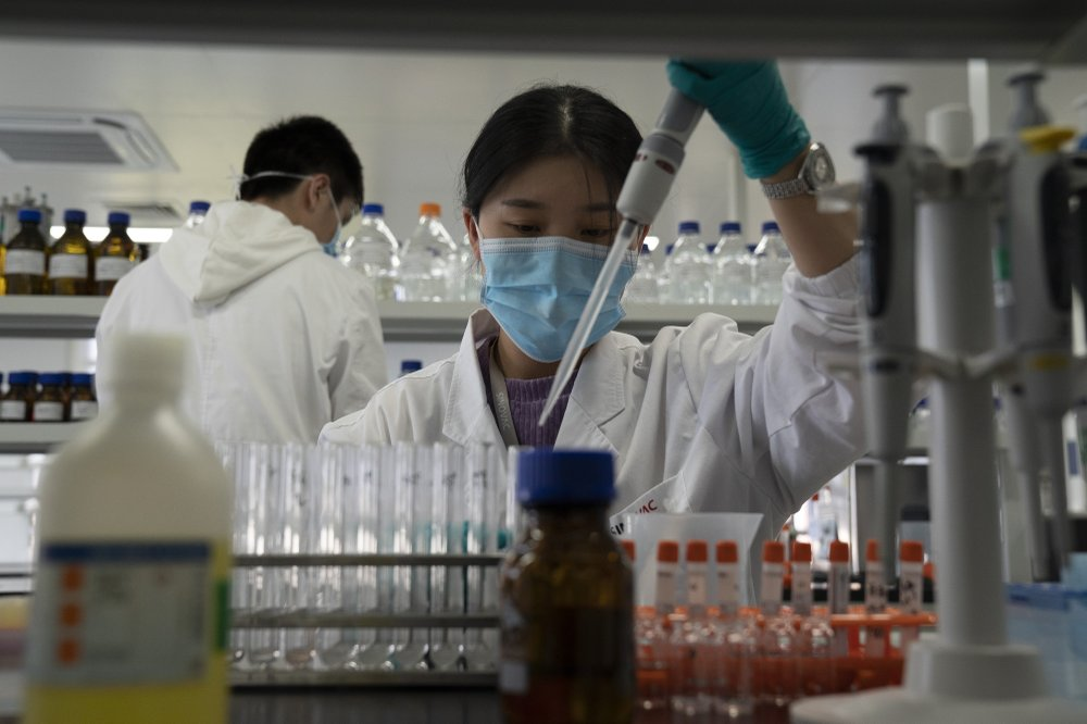 An employee of SinoVac works in a lab at a factory producing its SARS CoV-2 Vaccine for COVID-19 named CoronaVac in Beijing on Thursday, Sept. 24, 2020. SinoVac's CEO says they have injected 90 percent of its employees and family members, or about 3,000 people, and provided tens of thousands of rounds of CoronaVac to the municipal government of Beijing. It's a highly unusual move that raises ethical and safety questions, as companies and governments worldwide race to develop a vaccine that will stop the spread of the new coronavirus.