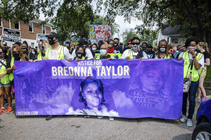 FILE - Protesters participate in the Good Trouble Tuesday march for Breonna Taylor, on Tuesday, Aug. 25, 2020, in Louisville, Ky. A lawyer for Breonna Taylor's family said a plea deal was offered to an accused drug trafficker that would have forced him to implicate Taylor, who was killed by police in a raid on her home in March. Louisville's top prosecutor acknowledged the existence of the document but said it was part of preliminary plea negotiations with a man charged with illegal drug trafficking and not an attempt to smear Taylor.
