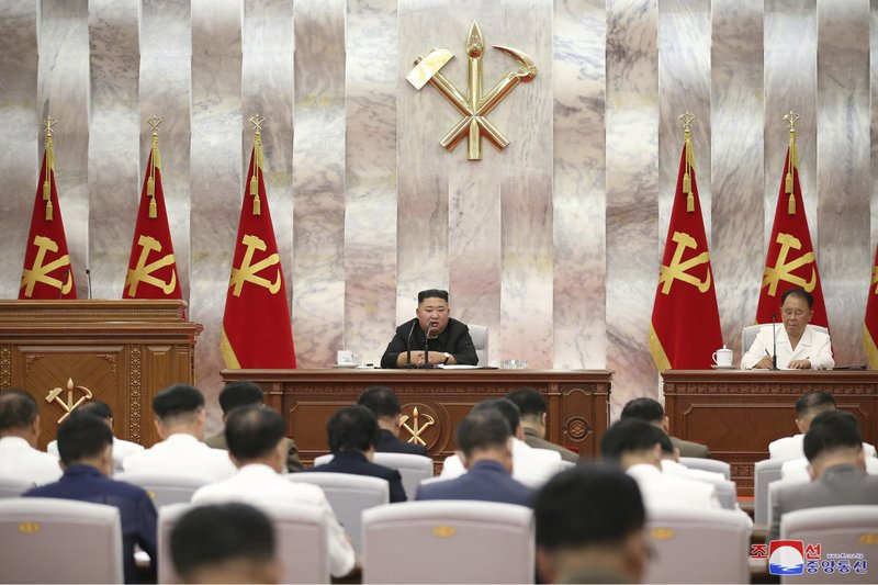 "In this photo provided by the North Korean government, North Korea leader Kim Jong Un speaks during a Workers' Party meeting in Pyongyang, North Korea, Tuesday, Sept. 8, 2020. Kim during the high-level political conference called for urgent efforts to rebuild thousands of homes and other structures destroyed by Typhoon Maysak that slammed the country's eastern region last week, state media said Wednesday, Sept. 9. Independent journalists were not given access to cover the event depicted in this image distributed by the North Korean government. The content of this image is as provided and cannot be independently verified. Korean language watermark on image as provided by source reads: ""KCNA"" which is the abbreviation for Korean Central News Agency."