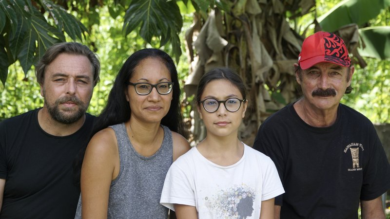 A group who have been stranded in Tahiti, pictured from left, Benjamin Baude, Kissy Ika Chavez Baude, Gaïa Baude Ika and Thierry Gourtay in Afareaitu on Moorea Island, Tahiti, Saturday, Sept. 19, 2020. A group of 25 residents from remote Easter Island has been stranded far from home for six months now. Many arrived in March planning to stay for just a few weeks. But they got stuck when the virus swept across the globe and their flights back home on LATAM airlines were canceled. LATAM says it doesn't know when it will restart the route.