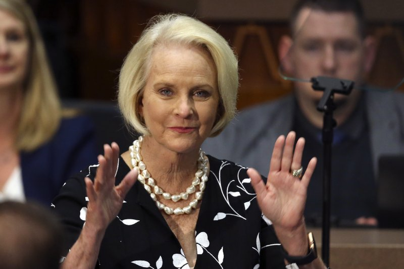FILE - In this Jan. 13, 2020, file photo Cindy McCain, wife of former Arizona Sen. John McCain, waves to the crowd after being acknowledged by Arizona Republican Gov. Doug Ducey during his State of the State address on the opening day of the legislative session at the Capitol in Phoenix. Democratic presidential candidate former Vice President Joe Biden said Sept. 22 that Cindy McCain plans to endorse him for president.