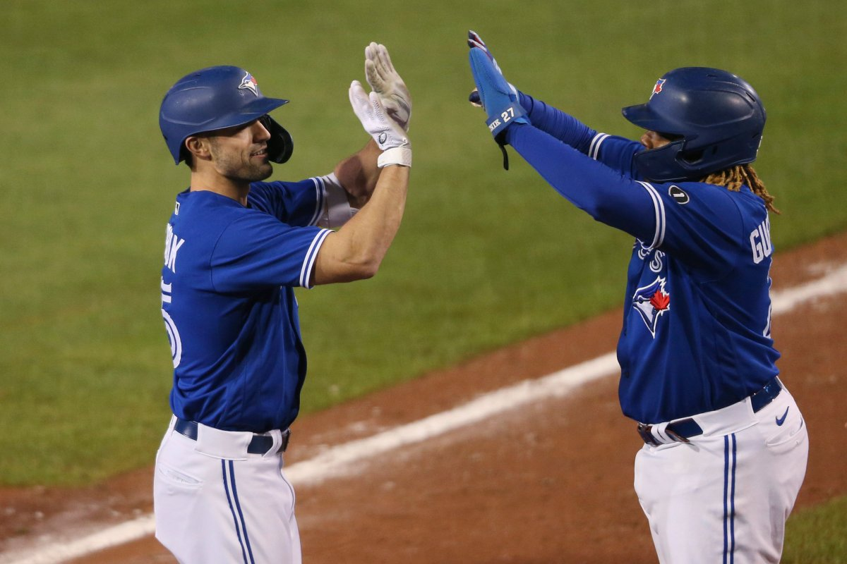Toronto Blue Jays Randal Grichuk, left, celebrates his three-run home run with Vladimir Guerrero Jr. during the seventh inning of the team's baseball game against the Baltimore Orioles, Saturday, Sept. 26, 2020, in Buffalo, N.Y.