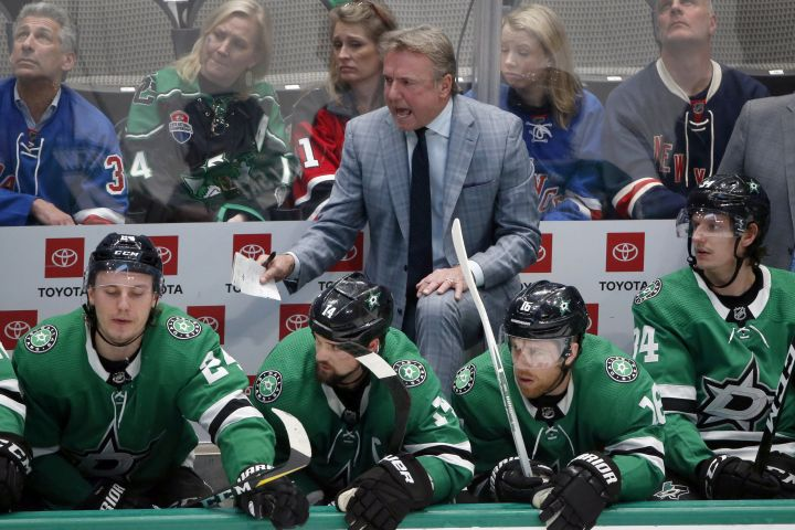 In this March 10, 2020, file photo, Dallas Stars interim head coach Rick Bowness yells from the bench as they played the New York Rangers during the third period of an NHL hockey game in Dallas.