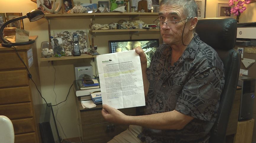 Doug Collicut, a long time cottage owner at Star Lake, reviews a letter he received from the province regarding a new development near his property.