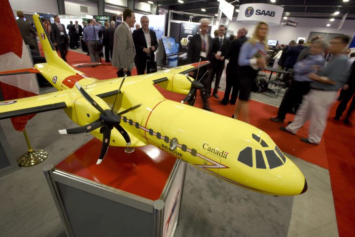 FILE: Delegates pass a model of the Airbus C295 fixed wing search and rescue aircraft at the Canadian Association of Defence and Security Industries' CANSEC trade show in Ottawa on Wednesday, May 27, 2015.
