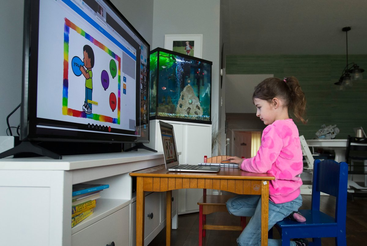 Six-year-old Peyton Denette works remotely from her home in Mississauga, Ont., on Monday, March 30, 2020.