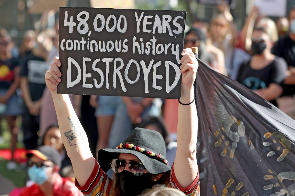 Protesters are seen during a rally outside the Rio Tinto office in Perth, Australia, 09 June 2020. Rio Tinto recently detonated explosives in an area of the Juukan Gorge in the Pilbara, destroying two ancient deep-time rock shelters, much to the distress of the Puutu Kunti Kurrama and Pinikura people.