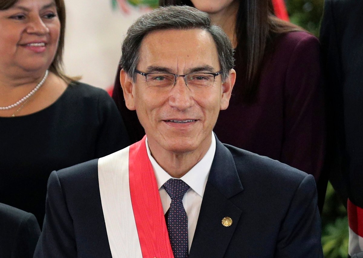 FILE - In this Oct. 3, 2019 file photo, Peru's President Martin Vizcarra smiles after the swearing-in ceremony of his new cabinet at the government palace in Lima, Peru. On July 28, 2020, the anniversary of independence, Vizcarra tried in a televised speech to galvanize a country battered, like so many others around the world, by economic calamity and mass death from the new coronavirus.