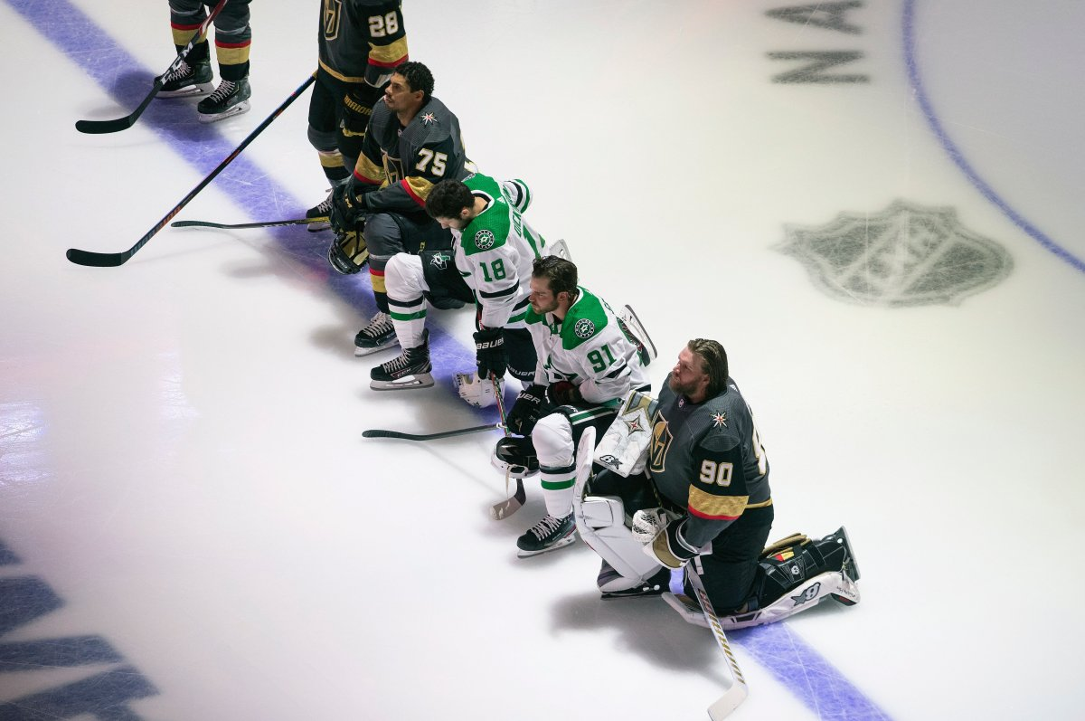 FILE - In this Aug. 3, 2020, file photo, Dallas Stars' Jason Dickinson (18), Tyler Seguin (91) and Vegas Golden Knights' Ryan Reaves (75) and goalie Robin Lehner (90) take a knee for Black Lives Matter during the national anthem prior to an NHL hockey playoff game in Edmonton, Alberta.