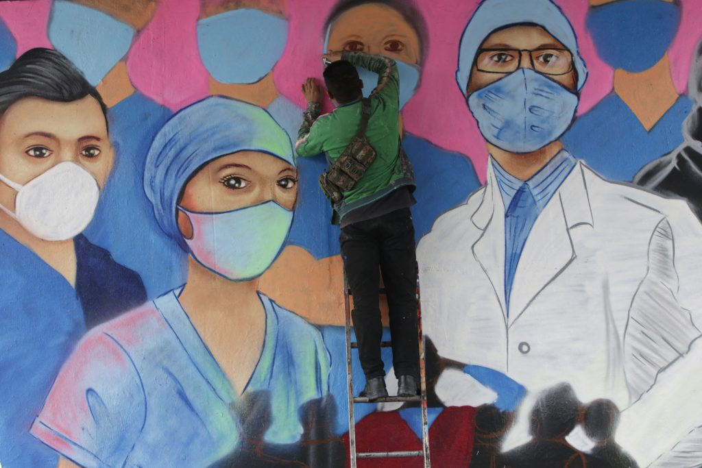 A urban artist makes a mural in memory of all health workers who lost their lives in the midst of the COVID-19 pandemic on August 25, 2020 in Mexico City, Mexico. Because the authorities have not provided the necessary medical supplies, doctors face a high risk of contagion by coronavirus.