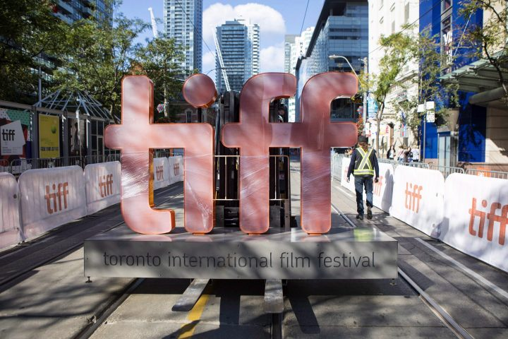 A sign bearing the Toronto International Film Festival logo is carried on a forklift down street in downtown Toronto as preparations are made for the festival's opening night on Thursday September 7, 2017.